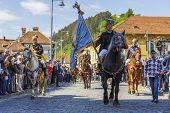 Senior Horseman Holding Flag During Brasov Juni Parade