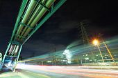 Industrial factory with traffic trail at night