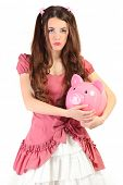 cute young woman dressed as a doll holding pig