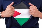 Young Sport Fan Opening His Shirt And Showing The Flag His Country Jordan, Jodanian Flag