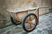 stock photo of hand-barrow  - Old Hand building wheelbarrow designed for masons - JPG