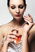 elegant bride applying perfume on her wrist