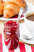 Raspberry jam and croissants.