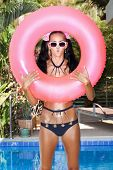 Woman In White Sunglasses With Pink Inner Tube