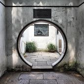 stock photo of yuan  - Round doorway in ancient Yu Yuan Garden in Shanghai - JPG