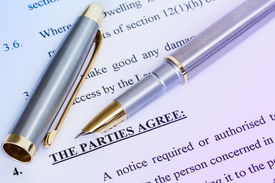 pic of rental agreement  - Metal pen with agreement between landlord and tenant - JPG