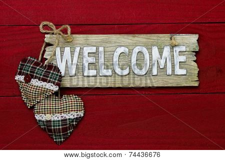 Wood Welcome Sign With Plaid Country Christmas Hearts Hanging On Dark Red Background Poster