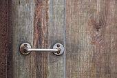 Door Handle On Wood Background