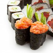 Sushi Set - Different Types of Maki Sushi and Nigiri Sushi. Served on Green Leaves