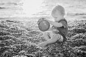 Cute Toddler Boy Playing On The Beach