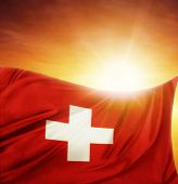 Swiss flag in front of bright sky