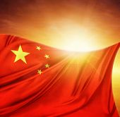 Chinese flag in front of bright sky