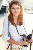 Travel tourist woman with camera. Tourism concept