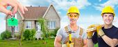 Handyman with a hammer. House renovation and construction background.