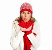 Happy woman in winter clothing isolated over white background.