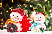 image of knitted cap  - Knitted snowmen and handmade Christmas tree  - JPG