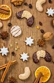Many Christmas cookies on a wooden background