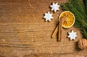 A rustic wooden background with Christmas decorations