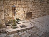 Rusty fountain in Oldtown of Molfetta. Apulia.