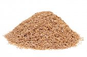 a pile of wheat bran on a white background