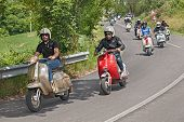 Bikers Riding A Vintage Scooters Lambretta