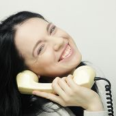 young happy woman with vintage phone, studio shot