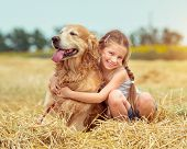 picture of labradors  - happy little girl with her dog golden retriever in rural areas in summer - JPG