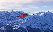 image of helicopters  - Red helicopter at swiss alps near Jungfrau mountain - JPG