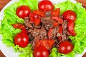 Roasted beef and mushrooms with tomato and lettuce
