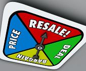 picture of bartering  - Resale word on a board game spinner to reach a deal - JPG