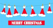 foto of clotheslines  - Santa claus hats on a clothesline with a yellow bird and merry christmas message - JPG