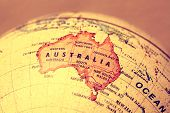 picture of longitude  - Australia on a printed   atlas world map - JPG