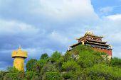 stock photo of tibetan  - The biggest Buddhist prayer wheel in the world in Shangri - JPG