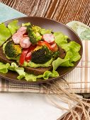 image of veal  - beautiful healthy nutritious delicious sandwich made of veal sausage fried broccoli and red pepper - JPG
