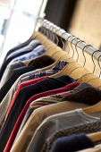 stock photo of boutique  - Hanging clothes on hangers in a fashion boutique - JPG