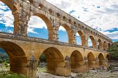 stock photo of aqueduct  - Pont du Gard is an old Roman aqueduct near Nimes in Southern France - JPG