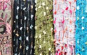 picture of handicrafts  - Colorful scarf is hanging in the handicraft shop - JPG