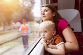 stock photo of lap  - Mother with son in her lap traveling in train - JPG