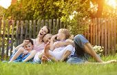 pic of father time  - Happy young family spending time together outside in green nature - JPG