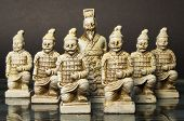 stock photo of humility  - White King and his soldiers are standing on a glass chessboard  - JPG