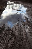 pic of boggy  - Mud and puddles on the dirt road - JPG