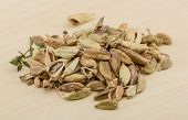 picture of cardamom  - Dry Cardamom heap on the wood background  - JPG