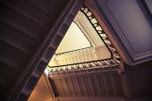 picture of fragmentation  - Abstract interior fragment triangle shaped flight of stairs looking up. Vintage toned photo with old style filter effect ** Note: Visible grain at 100%, best at smaller sizes - JPG