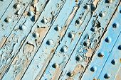 foto of nail paint  - stripped paint in the blue wood door and rusty nail - JPG