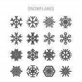stock photo of monochromatic  - Set of simple isolated monochromatic snowflake icons - JPG