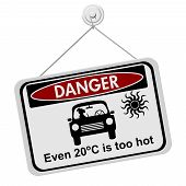 stock photo of car symbol  - Dangers of leaving a dog in parked cars A red and black danger sign with the symbols of dog in car isolated on a white background - JPG