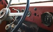 pic of steers  - Old bus interior view on steering wheel and control table - JPG