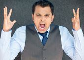 stock photo of nervous breakdown  - Closeup portrait of bitter displeased pissed off angry grumpy man in tie open mouth hands in air screaming and yelling isolated gray background - JPG