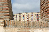 stock photo of ceuta  - Apartment house facade through loophole of castle wall in Ceuta Spain - JPG