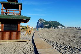stock photo of gibraltar  - View of the Rock of Gibraltar seen from a La Linea beach in Spain Gibraltar United Kingdom Western Europe - JPG